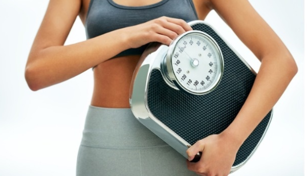 woman holding a scale. (Photo: Contributed)