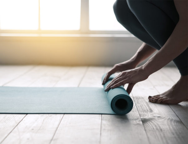 Yoga and Pilates require very little equipment and are low-impact, making them good for people with illnesses or injuries. (Photo: dima_sidelnikov/Getty Images)