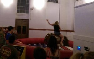 A visitor to last year's COWPIE attempts to ride a mechanical bull. (Photo: Wyoming State Society)