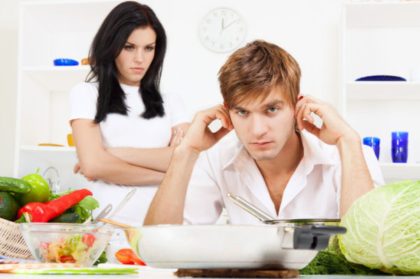 Man and woman arguing. Woman has arms crossed looking at man who has fingers in his ears. (Photo: Shutterstock)