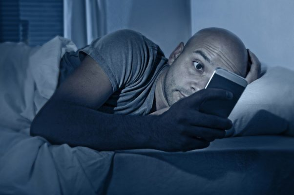 Don't use your phone or other electronic devices in bed. In fact, you should put down your devices a few hours before bedtime.  (Photo: Getty Images)