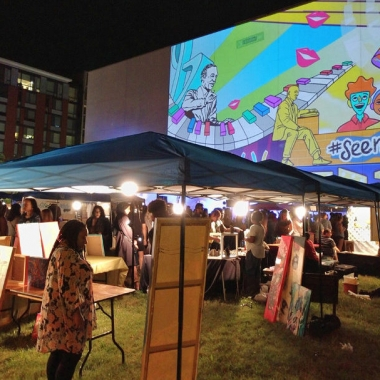 A giant animated Love Shaw projection looming over the art market. (Photo: Alexander M. Padro)
