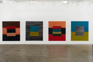 Four colorful paintings of horizontal lines by Sean Scully hang in the Hirshhorn. (Photo: Robert Bean)