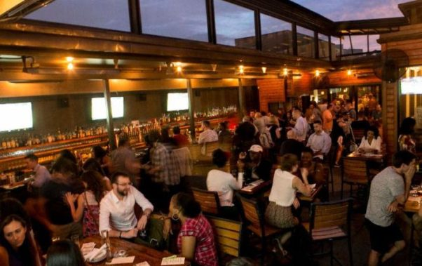 People in Jack Rose Dining Saloon's rooftop bar. (Photo: Jack Rose Dining Saloon)