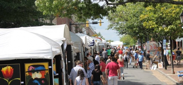 People walking along booths at the 2017 King Street Art Festival in Old Town. (Photo: Howard Alan Events)