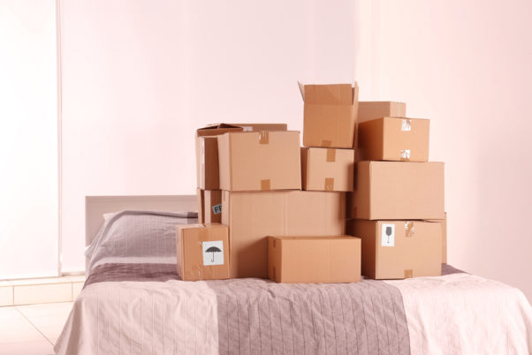 Packed household stuff in brown boxes for moving into new house. (Photo: Depositphotos)