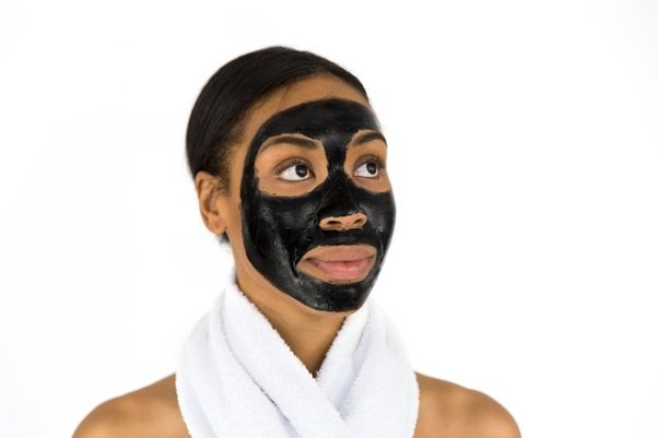 African American woman with a charcol face mask on. (Photo: bridgesward/Pixabay)