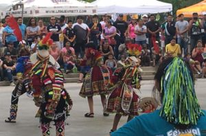 Visitors watch dancers dressed in native costumes at Fiesta D.C. (Photo: Fiesta D.C./Facebook)