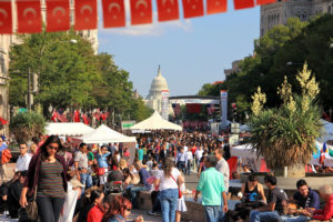 Visitors to the Turkish Festival walking among the booths set up at Freedom Plaza wth the U.S. Capitol in the background. (Photo: Turkish Festival)