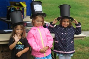 Three young girls wearing stove pipe hats they made during Homecoming at President Lincoln's Cottage. (Photo: President Lincoln's Cottage)