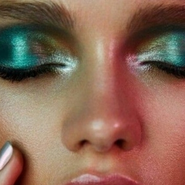 Woman's eyes with metallic green eyeshadow. (Photo: GirlsCosmo)
