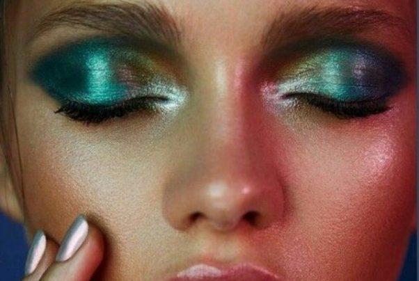 Woman's eyes with metallic green eyeshadow. (Photo: GirlsCosmo)