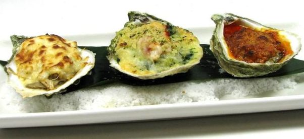 Three baked oysters on a plate. (Photo: Legal Sea Foods)