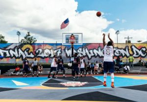 A player shoots at the basket in 2017's Red Bull Reign USA 3-on-3 final on an outdoor court. (Photo: Red Bull)