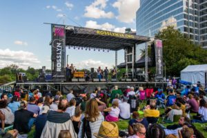 Crowds sitting on the lawn watch a band perform on stage at last year's Rosslyn Jazz Festival. (Photo: Rosslyn BID)