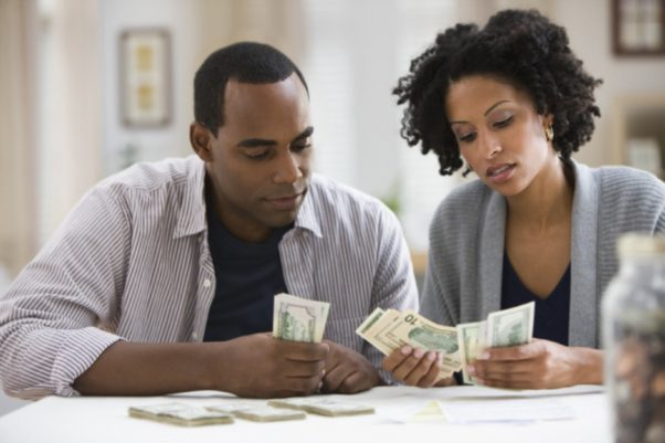 African American couple counting money. (Photo: Getty Images)