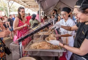 A woman purchases food from Bangkok Joe's at the 2017 Taste of Georgetown. (Photo: Sam Kittner)