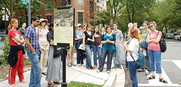 A group of people on a walking tour gathered around the guide. (Photo: Tourism D.C.)