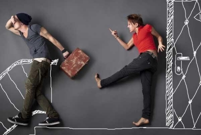 A woman kicking a man on a gray background with the door, steps and rail hand drawn. (Photo: Shutterstock)