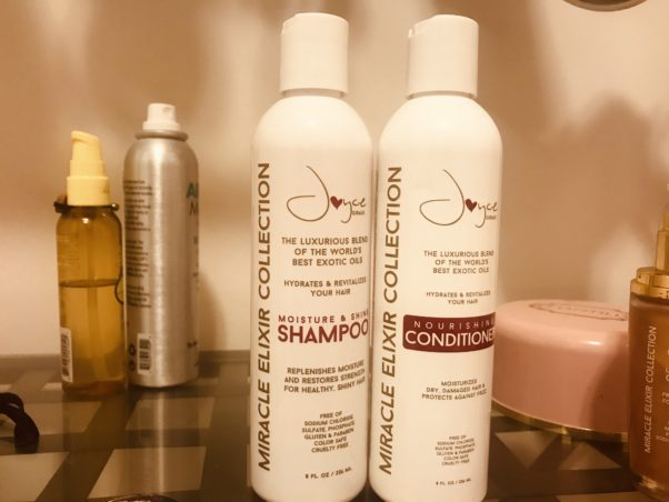Bottles of shampoo and conditioner from the Joyce Giraud Miracle Elixir Collection sitting beside each other on a bathroom counter. (Photo: Emma Blancovich/DC on Heels)