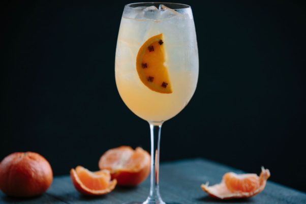 Legal Sea Food's Clementine Sangria with a slice of orange floating in it and clemintines on the table around it. (Photo: Brian Samuels)
