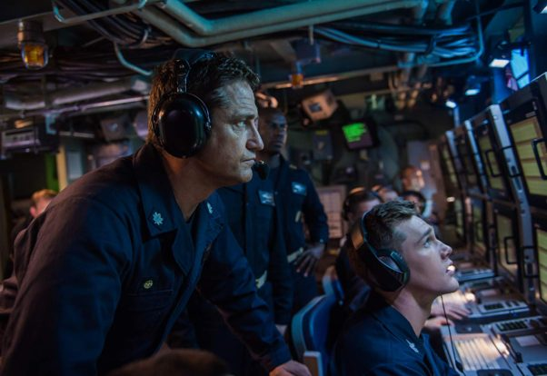 Gerard Butler in a submarine control room wearing headphones and looking at a monitor. (Photo: Lionsgate Entertainment)