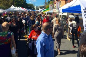 Visitors at a past Takoma Park Street Festival stroll past booths. (Photo: Main Street Tacoma)