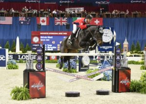 McLain Ward on Queen Jane in the Caps Jump on Thursday jumps over an obstacle decorated with Stanley Cups, hockey sticks and pucks. (Photo: Shawn McMillen Photography)