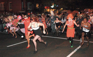 Drag queens race down 17th Street NW. (Photo; Metro Weekly)