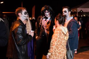 Adults dressed in costumes including ghouls and a giraffe at Night of the Living Zoo. (Photo: Jim Jenkins/FONZ)