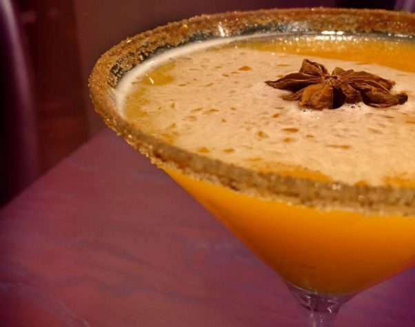 A close up shot of a pumpkin spice martini with a clove anise floating on top. (Photo: Jardenea Lounge)