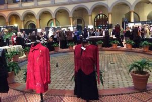People shopping at Craft2Wear with clothing displayed on manequins. (Photo: Smithsonian Craft2Wear)