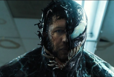 Tom Hardy changing into Venom. (Photo: Sony Pictures)