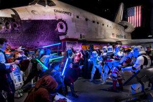 Children and adults dressed in costumes from Star Wars about to battle in front of the Space Shuttle Discovery. (Photo: Udvar-Hazy Center)