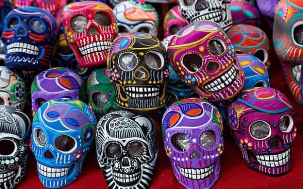 Several colorfully decoraed Day of the Dead skulls. (Photo: Eva Rinaldi/Flickr)