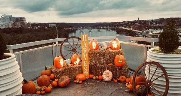 A Halloween display on the rooftop of the Watergate Hotel of pumpkins, straw bales, a wagon wheel and jack-o-lanterns carved to look like famous people. (Photo: Watergate Hotel)