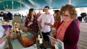 People drinking wine under a tent at Mount Vernon. (Photo: Mount Vernon)