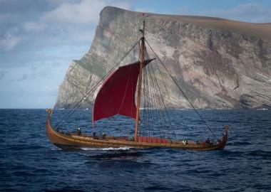The Viking ship Draken Harald Hårfagre sailing past a cliff. (Photo Viking Nilsson):