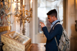 A man taking a photo of something in a display case. (Photo: Anderson House)