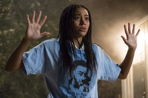 Actress Amandla Stenberg in The Hate U Give with her hands raised wearing a T-shirt of a boy the police shot. (Photo: 20th Century Fox)