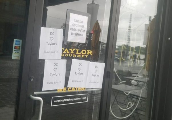 "The door to the Taylor Gourmet at the Wharf with a sign that says ""Taylor Gourmet Closed for Business"" taped to it. (Photo: Popville)"
