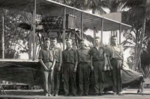 The flyers of the Millonaire's Unit standing in front of a plane. (Photo: Screen Capture)