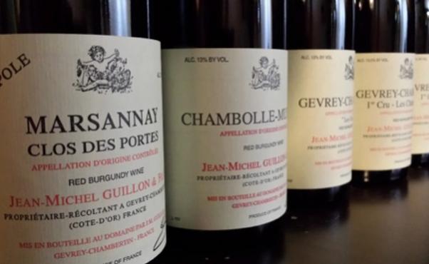 Three bottles of Jean-Michel Guillon wine sitting beside each other. (Photo: Bourbon Steak)