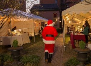 Santa Claus walks down the rows of vendors under tents at Heurich House Museum's Chriskindlmarkt. (Photo: Heurich House Museum)