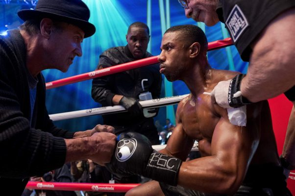 Rocky Balboa (Sylvester Stallone) talks to Adonis Johnson (Michael B. Jordan) in the corner of the ring during a boxing match. (Photo: MGM)