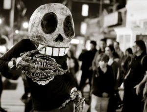 A person dressed in a skelton costume parading along Georgia Avenue. (Photo: Victoria Pickering/Flickr)