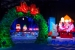 Ice cavrings of Snoopy lying on his dog house while Charlie Brown and Linus lean on a wall looking through a giant werath with a red bow. (Photo: Gaylord National Resort)