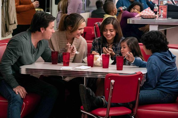 Mark Wahlberg and Rose Byrne with their adopted family eating a banana split in Instant Family. (Photo: Paramount Pictures)