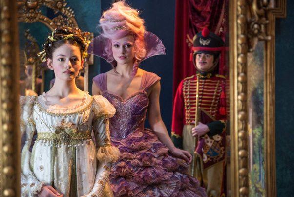 Clara and the Sugar Plum Fairy in a mirror as a soldier looks on. (Photo: Walt Disney Studios)