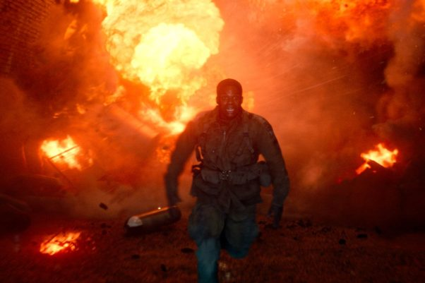 Jovan Adepo as Boyce runs out of a burning building in Overlord. (Photo: Paramount Pictures)